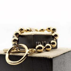 pulsera-dorado-barra-aro-elegante